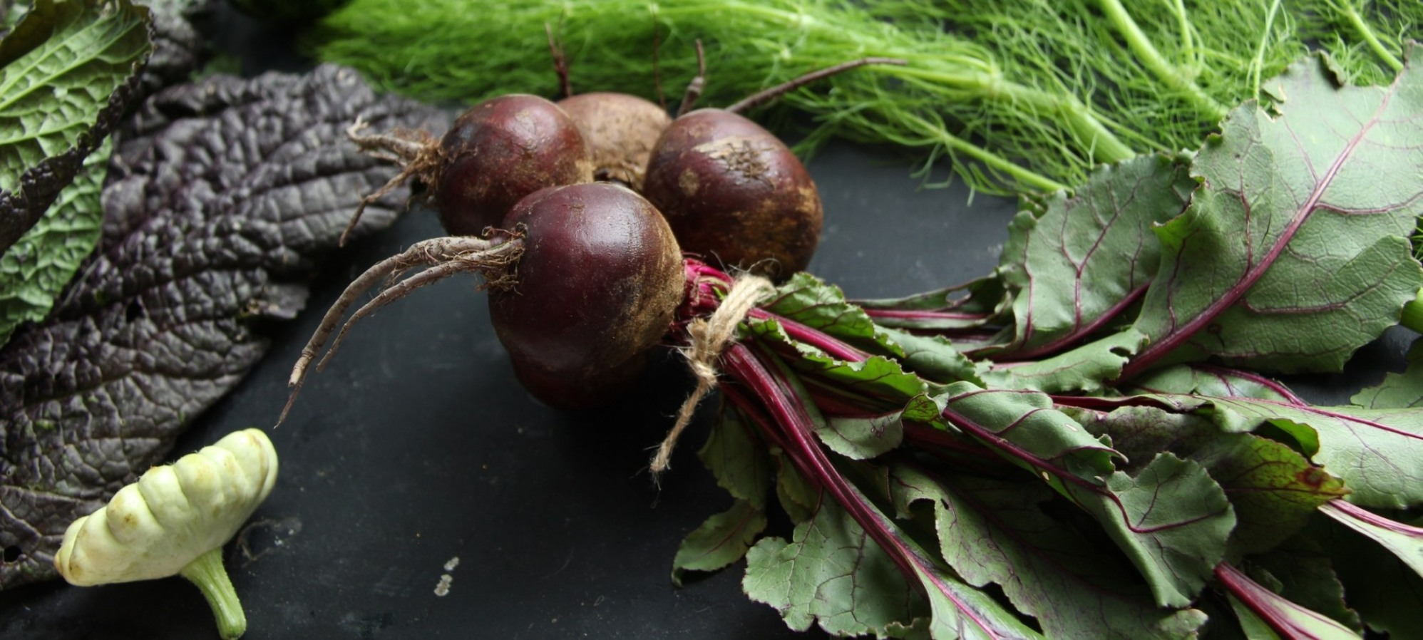 Purple whole beets with greens